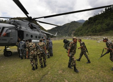 Nepal army soldiers get down from an Indian Air Force helicopter at higher reaches of mountains to help and evacuate earthquake victims.