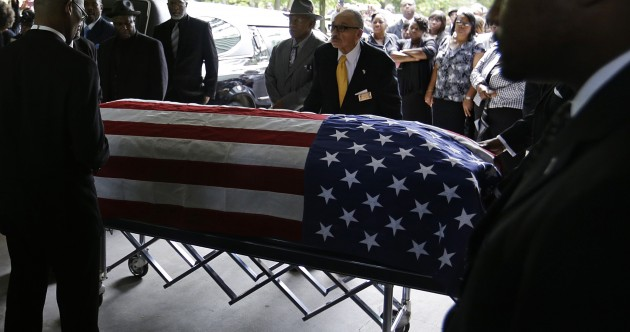 """I don't think he ever met an enemy"": Man shot by police officer is laid to rest"