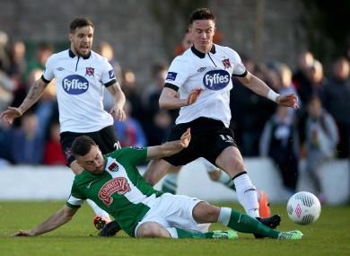 Dundalk midfielder Ronan Finn is tackled by Cork's Ross Gaynor.