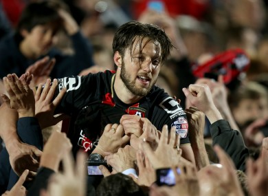 Bournemouth's Harry Arter celebrates with fans on the pitch after the final whistle against Bolton last Monday.