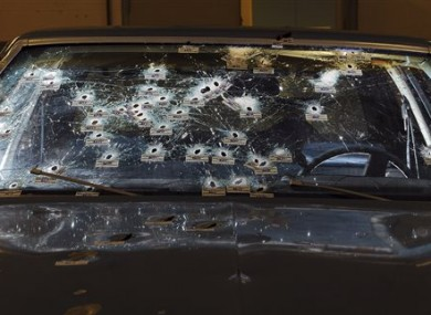 The bullet-ridden windshield of the car.