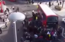 Watch the moment a huge crowd lifted a double decker bus off a trapped unicyclist