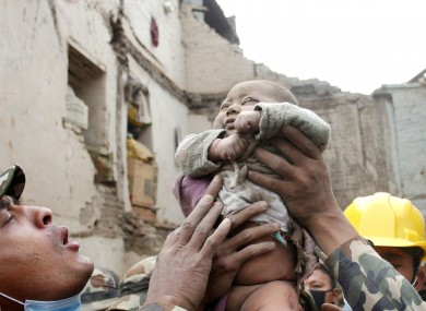 A four-month-old baby boy is rescued from the rubble of his house in Bhaktapur, last Sunday.