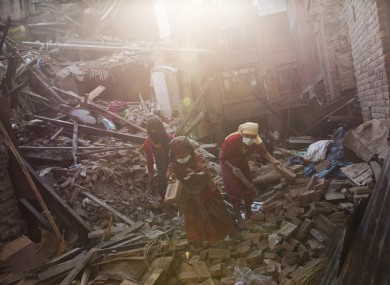 Survivors of Nepal earthquake search for their belongings in the debris.