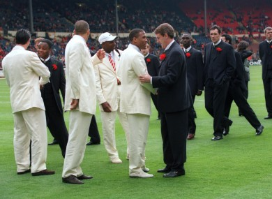Manchester United's Steve Bruce admires Liverpool's John Barnes' suit as the two teams stroll across the pitch before the 1996 FA Cup final.