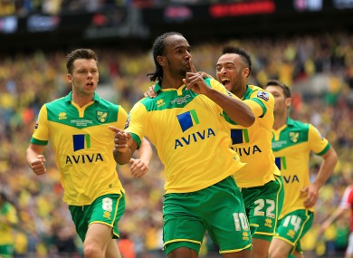 Norwich City's Cameron Jerome (centre) celebrates scoring his side's first goal.
