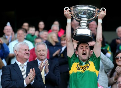 Kerry' captain John Griffin lifts the Christy Ring Cup.