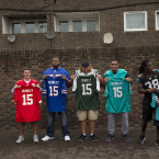 NFL players, from left, Detroit Lions running back Joique Bell, Kansas City Chiefs' Brazilian kicker Cairo Santos, Buffalo Bills offensive tackle Cordy Glenn, New York Jets center Nick Mangold, Miami Dolphins defensive end Olivier Vernon and Jacksonville Jaguars safety Sergio Brown pose for group photographs with Wembley shirts during an NFL Summer Bowl tournament for kids from six London schools that have taken part in a football and education programme, at the Black Prince Community Hub in south London, Wednesday, July 15, 2015. The NFL will stage three international series regular-season games in autumn 2015 at Wembley Stadium in London.<span class=
