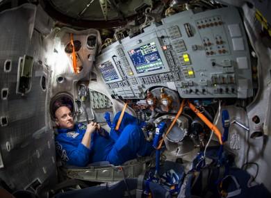 Astronaut Scott Kelly sits inside a Soyuz simulator at the Gagarin Cosmonaut Training Center