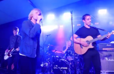 Gary Neville joins legendary Madchester band on stage to show off his guitar skills