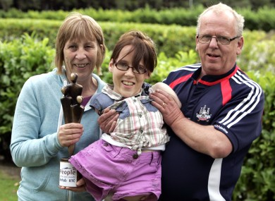 Joanne O'Riordan from Cork with her parents Anne and Joe. Joanne, who was born without arms or legs, is one of just seven people in the world who suffers with a rare condition known as total Amelia.