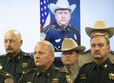 Law enforcement officers stand together after the fatal shooting.
