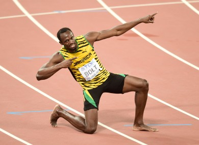 Jamaica's Usain Bolt celebrates after winning the gold medal in the Men's 200 Metres final.