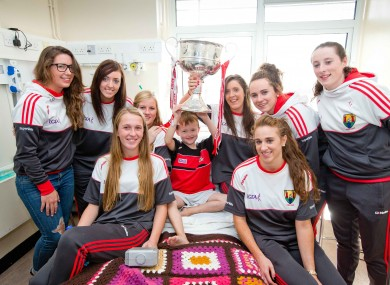 The Cork ladies footballers visited Crumlin's Childrens Hospital this morning with the Brendan Martin Cup.