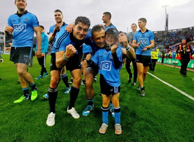 The Brogan brothers and Alan's son Jamie celebrate Dublin's victory.