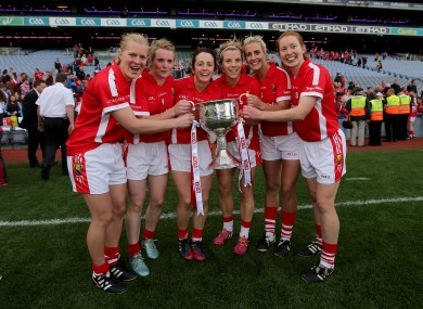Geraldine O'Flynn (third from left) celebrates victory with her teammates.