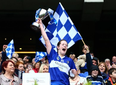 Laois captain Niamh Dollard lifts the cup.