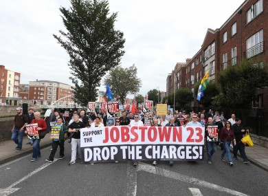 Protesters marched from the Central Bank up to the Courts of Criminal Justice in Dublin.