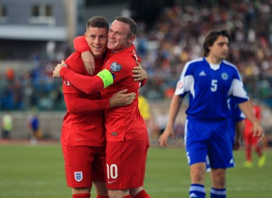 England's Ross Barkley (left) celebrates scoring his side's third goal of the game with Wayne Rooney.