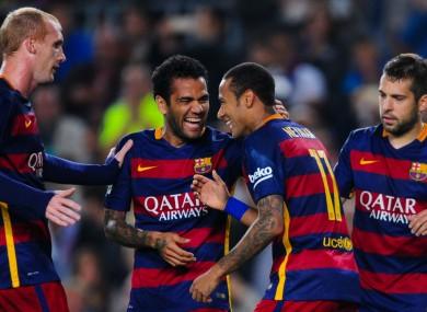 Barcelona players celebrate with Neymar.