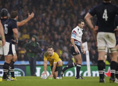 Australia's Bernard Foley prepares to kick the match-winning penalty beside referee Craig Joubert.