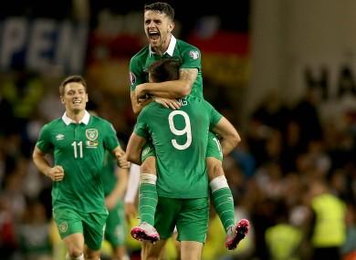 Robbie Brady hugs goalscorer Long.