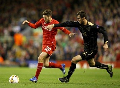 Rubin Kazan's Solomon Kvirkvelia (right) and Liverpool's Adam Lallana battle for the ball.