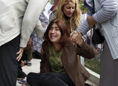 A relative of a person killed in Saturday's bombing attack reacts outside a hospital's morgue as they wait for the funeral in Ankara.