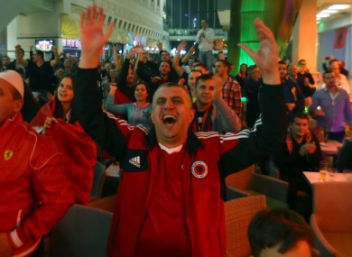 Albanian fans celebrate beating Armenia.