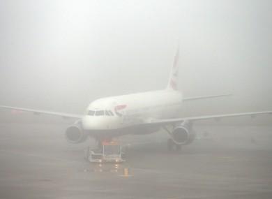 Fog on the runway at Heathrow airport.
