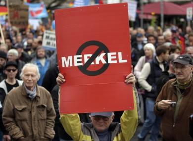 People take part in a protest rally of the German party 'Alternative fuer Deutschland, AfD' (Alternative for Germany) in Berlin.