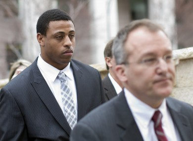 Greg Hardy (background) appearing in court after domestic violence charges against him were dismissed earlier this year.