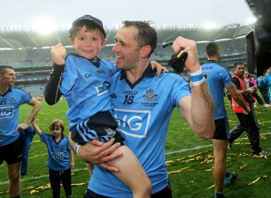 Dublin's Alan Brogan celebrates with his son Jamie after winning the All-Ireland earlier this year.