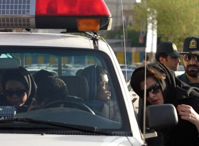 File photo from 2007: Women who were detained for not adhering to the strict Islamic dress code sit in a police vehicle in Tehran