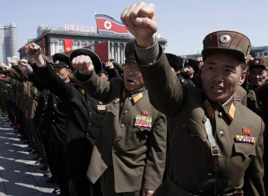 North Korean army officers punch the air as they chant slogans during a rally in Pyongyang.