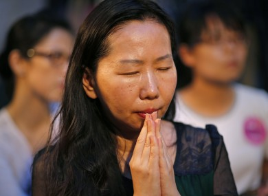 A woman prays during a memorial for Taiwan's