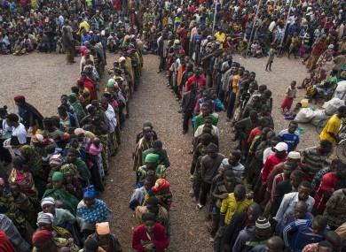 Tanzania. Burundian refugees collect food vouchers in Kigoma Stadium
