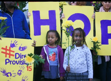 Stephanie Nganga aged 5 and Tatiana Nganga aged 8 taking part in a moment of silence for victims of Direct Provision by asylum seekers at a demonstration last year.