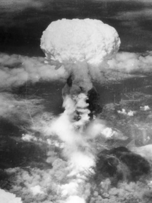 A giant column of smoke rises more than 60,000 feet into the air, after the second atomic bomb ever used in warfare explodes over the Japanese port town of Nagasaki, on 9 August, 1945.
