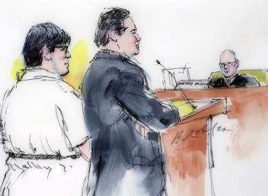 In this courtroom sketch, Enrique Marquez, left, appears with his defense attorney Young Kim in federal court in Riverside, California.