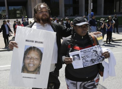 Alfredo Williams, left, and Renee Robinson, cousins of Malissa Williams who is one of the victims, protests outside the courthouse after the Michael Brelo verdict in May last year.