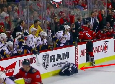 Wideman leaves the official flat on the ice.