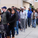 Queues to buy tickets on Saturday in California.<span class=