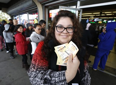 Laura Woodward  yesterday buying lottery tickets for her office pool