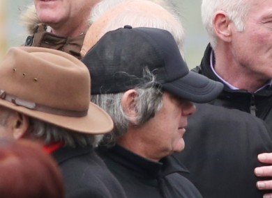 Hutch, pictured wearing a wig as a disguise at his brother's funeral on Friday.