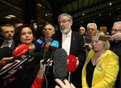 Gerry Adams and Mary Lou McDonald flanked by Sinn Féin members at the RDS today