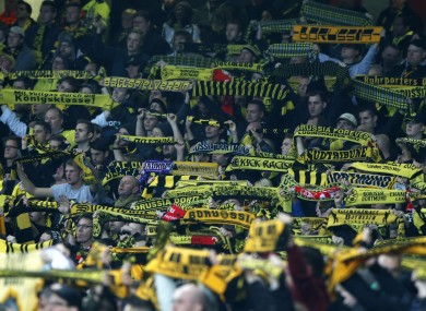 Dortmund fans are unhappy at being charged high prices for tickets.