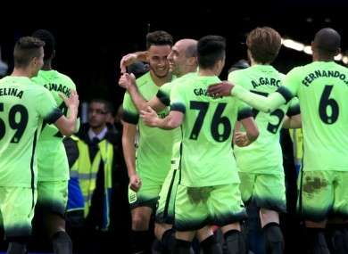 Manchester City players celebrate David Faupala's goal.