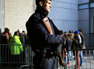 A French riot police officer stands guard at the entrance of the Stade de France prior to the Six Nations rugby match between France and Italy