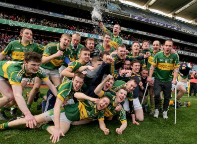 Ger Aylward (right) in crutches with his Glenmore teammates as they celebrate their All-Ireland win in Croke Park today.